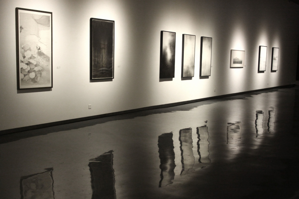 reflections of art; a gallery at M50, Moganshan Lu, photograph by Shanghai by Bel
